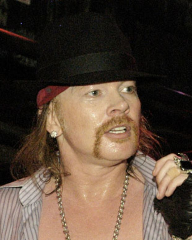 Axl Rose performs with Guns N' Roses at John Varvatos on February 11, 2010 in New York City.