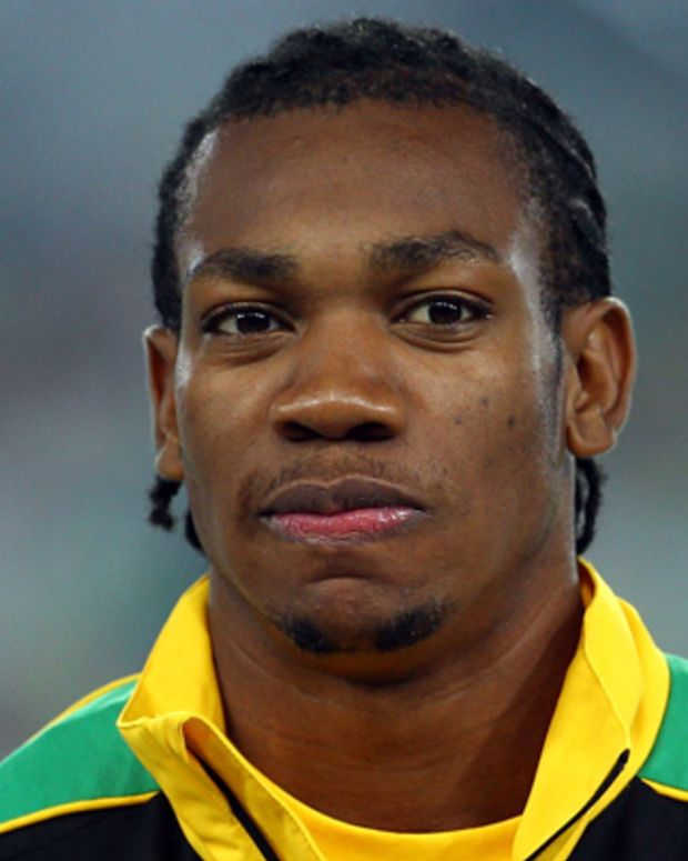 DAEGU, SOUTH KOREA - AUGUST 29:  Gold medalist Yohan Blake of Jamaica looks on from the podium before receiving his medal for the men's 100 metres during day three of 13th IAAF World Athletics Championships at the Daegu Stadium on August 29, 2011 in Daegu, South Korea.  (Photo by Mark Dadswell/Getty Images)