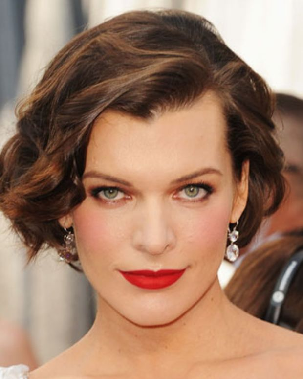 HOLLYWOOD, CA - FEBRUARY 26:  Actress Milla Jovovich arrives at the 84th Annual Academy Awards held at the Hollywood & Highland Center on February 26, 2012 in Hollywood, California.  (Photo by Jason Merritt/Getty Images)