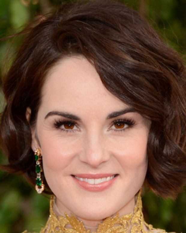 BEVERLY HILLS, CA - JANUARY 13:  Actress Michelle Dockery arrives at the 70th Annual Golden Globe Awards held at The Beverly Hilton Hotel on January 13, 2013 in Beverly Hills, California.  (Photo by Jason Merritt/Getty Images)