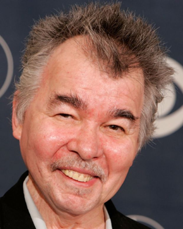 LOS ANGELES, CA - FEBRUARY 08:  Musician John Prine poses with his award for Best Contemporary Folk Album in the press room at the 48th Annual Grammy Awards at the Staples Center on February 8, 2006 in Los Angeles, California.  (Photo by Kevin Winter/Getty Images)