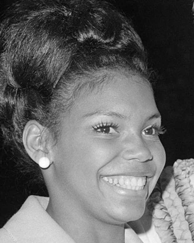 George D. Fischer, President of the National Education Association, presents Miss Iowa-19-year-old Cheryl Brown to NEA delegates at their meeting on July 6, 1970 in San Francisco. Miss Browne, a graduate of the New York City High School of the Performing Arts, is a student at Luther College in Decorah, Iowa. Shell compete in this years Miss America pageant. (AP Photo/RWK)