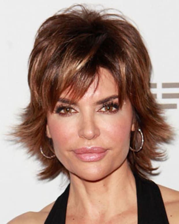 BEVERLY HILLS, CA - SEPTEMBER 21:  Actress Lisa Rinna poses at the Softcup Beauty Retreat With ZING Vodka Cocktails - Day 2 on September 21, 2012 in Beverly Hills, California.  (Photo by Todd Oren/WireImage)