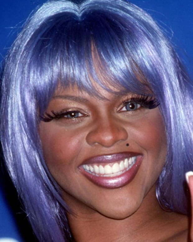 371945 02: FILE PHOTO: Rap Artist Lil'' Kim attends the 1999 MTV Video Music Awards September 9, 1999 in New York City. The U.S. Postal Service has announced June 29, 2000 that it refused to deliver 1,500 copies of the July 2000 issue of the L.A. based 'Genre' magazine featuring the female rapper on the cover, considering it too suggestive for regular mail. (Photo by Brenda Chase/Online USA)