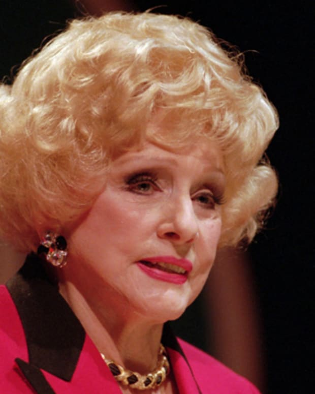 Cosmetics queen Mary Kay Ash speaks to her sales force in San Antonio, Texas, on Jan. 11, 1996. For 30 years, she has led her own cosmetics empire, mesmerizing and inspiring an army of women who peddle Mary Kay Corp.'s lipsticks, eyeshadows and creams door-to-door. But this February the 78-year-old makeup matriarch suffered a stroke, forcing her miss the company's annual pep rally. (AP Photo/Tommy Hultgren)