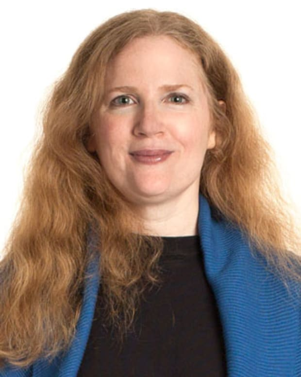 Hunger Games author Suzanne Collins poses for a portrait session at Matt Peyton Photography Studios, August 8, 2008 in New York City. (AP Photo/Matt Peyton)
