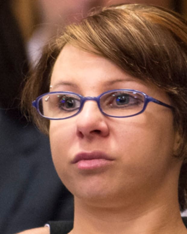 CLEVELAND, OH - AUGUST 1:  Michelle Knight (L) sits with her attorney during the sentencing of Ariel Castro on August 1, 2013 in Cleveland, Ohio. Castro was sentenced to life without parole plus one thousand years for abducting three women, including Knight, from 2002 and 2004 when they were between 14 and 21 years old. The women escaped this past May.  (Photo by Angelo Merendino/Getty Images) (Photo by Angelo Merendino/Getty Images)