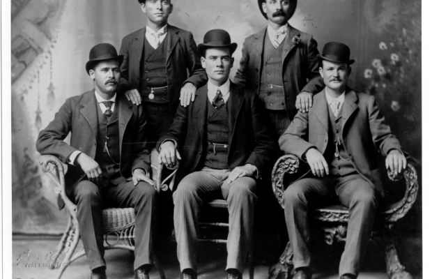 Icons of the Wild West: Portrait of the American outlaw gang The Wild Bunch, Texas. From left to right, standing: William Carver, Harvey 'Kid Curry' Logan. Seated: Harry 'Sundance Kid' Langbaugh (1870 - 1909), Ben 'The Tall Texan' Kilpatrick, Robert LeRoy 'Butch Cassidy' Parker (1866 - 1909). From the original photograph by John Swartz.