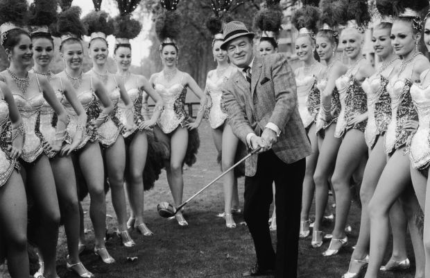 Celebrity Golfers: Set to appear in Britain's Royal Variety Performance, Bob Hope snaps a pic just outside of The Dorchester Hotel in London in 1967, to pose with a series of showgirl gams, courtesy of the Bluebell Girls dance troupe.