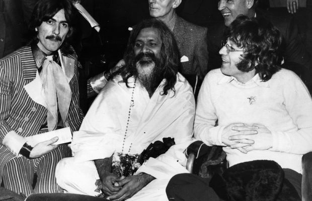 John Lennon Photo Gallery: Maharishi Mahesh Yogi was the Indian mystic who introduced British pop group The Beatles to transcendental meditation. Here he sits with George Harrison and John Lennon at the UNICEF Gala in Paris. (Photo: Getty Images)