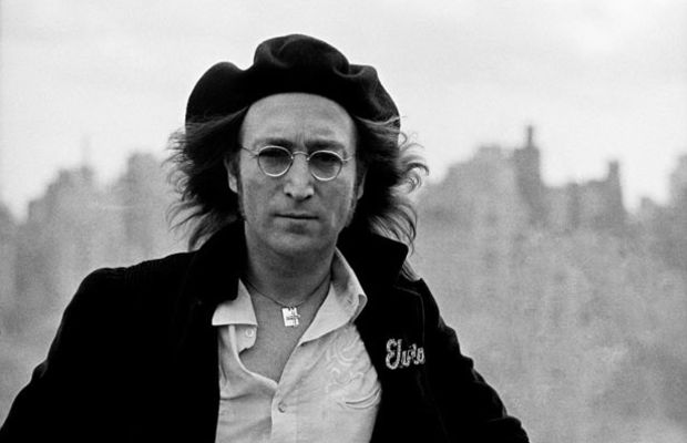 John Lennon Photo Gallery: John decided that he wanted to be a 'rocker,' after hearing Elvis Presley sing 'HeartBreak Hotel', and when Elvis and John met in 1965, Elvis was unsure of John's name, so he addressed him as 'Beatle. (Photo: Getty Images)