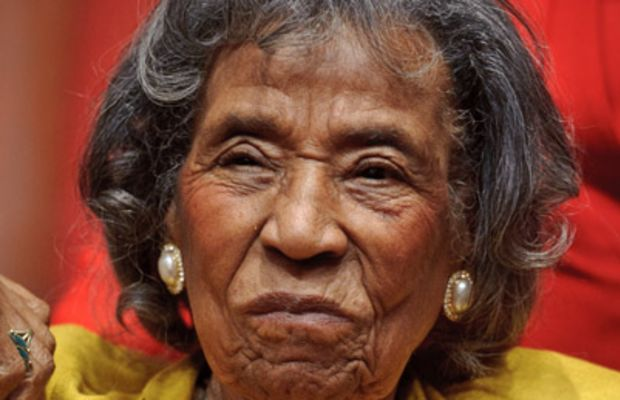 Mrs. Amelia Boynton, Integration Leader w. poster of George Wallace.  (Photo by Francis Miller//Time Life Pictures/Getty Images)