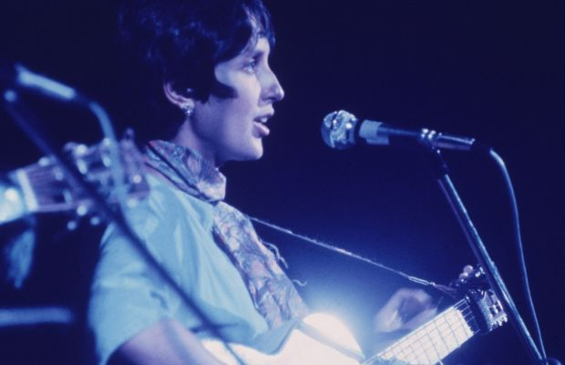 Woodstock Performers: Folk singer and anti-war activist Joan Baez, who was pregnant at the time, was the last act to take the stage on the first day of Woodstock. It was 1 a.m. and she wished everyone a 'good morning' to begin her set. (Photo by Fotos International/Getty Images)