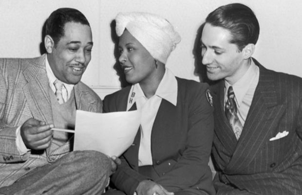 Billie Holiday: Jazz composer Duke Ellington sits with Billie Holiday and pianist and   music critic Leonard Feather in this 1945 photo. Holiday starred in a   short film with Ellington in 1935 and toured Europe with Feather in   1954.