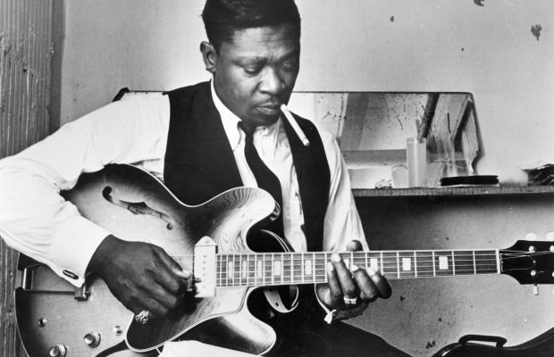 B.B. King: B.B. King tenderly holds his guitar Lucille in his portrait for Bluesway  Records in 1969. (Photo by Michael Ochs Archives/Getty Images)