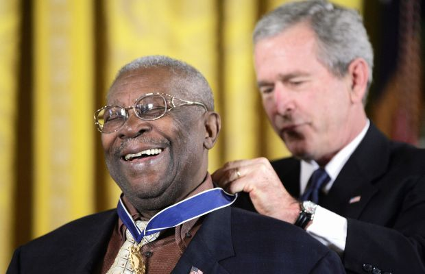 B.B. King: B.B.  King gives a big grin as U.S. President George W. Bush presents him with the  Presidential Medal of  Freedom in Washington D.C. on December 15, 2006. (Photo by TIM  SLOAN/AFP/Getty Images)