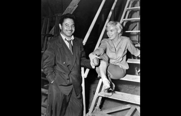 Marilyn Monroe: Photos by Sam Shaw: Photographer Sam Shaw and Marilyn Monroe, backstage at 20th Century Fox studio, Los Angeles, California, 1954. Shaw met Marilyn on the set of the movie Viva Zapata! At the time, Marilyn was director Elia Kazan's girlfriend and he asked her to drive Shaw to the set, the start of Monroe and Shaw's long friendship. Photos and text by Sam Shaw© Sam Shaw Inc./Licensed by Shaw Family Archives/ www.shawfamilyarchives.com