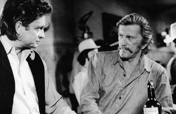 Cash and Kirk Douglas in 'A Gunfight' still, 1970. (Photo: Paramount Pictures/Courtesy ofGetty Images)