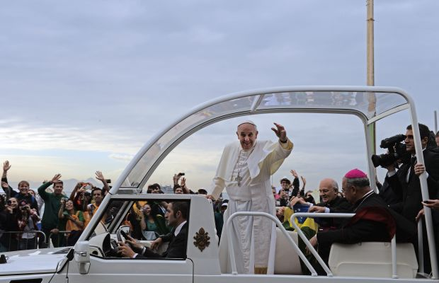 Pope Francis: Pope Francis cruises in his Popemobile and waves to the crowd during World Youth Day as he prepares for his final mass on July 28, 2013, in Rio de Janiero, Brazil. The following day his quote on homosexuality stunned many, saying 'If someone is gay and he searches for the Lord and has good will, who am I to judge?' (EVARISTO SA/AFP/Getty  Images)