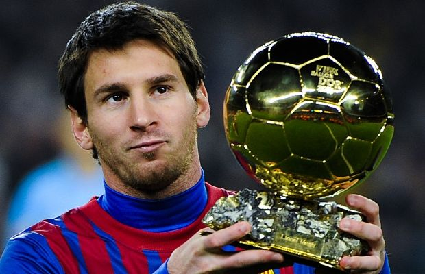 Messi with the Ballon d'Or trophy in Barcelona, Spain, in 2012. (Photo: David Ramos/Getty Images)