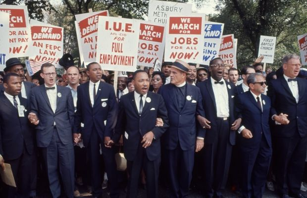 Civil Rights activists lead the March on Washington on August 28, 1963 including John Lewis (far left) and Reverend Martin Luther King Jr. (middle). (Photo by Robert w. Kelley/Getty Images)