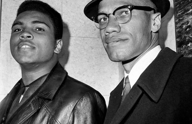 Malcolm X: Cassius Marcellus Clay, better known as Muhammad Ali, stands with fellow Muslim and civil rights activist Malcolm X in New York City on March 2, 1964. (Photo by John Peodincuk/NY Daily News Archive via Getty Images)