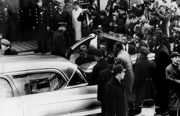 Malcolm X: The coffin of civil rights leader Malcolm X is exported into a vehicle on March 6, 1965, after his assassination. (Photo by Keystone-France/Gamma-Keystone via Getty Images)