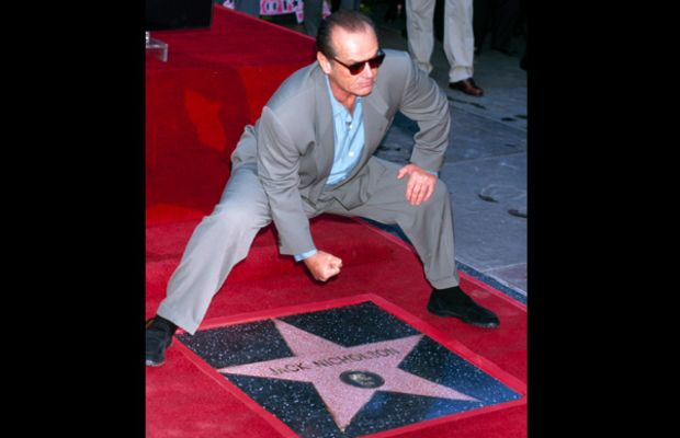 Jack Nicholson Photo Gallery: Star stance? Nicholson packs a punch as his star is unveiled on the Hollywood Walk of Fame in 1997.