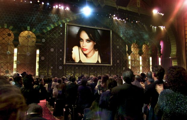 Aaliyah: Audience members watch as Aaliyah is posthumously awarded the Soul/R&B Favorite Female Artist Award at the 29th Annual American Music Awards in Los Angeles on January 9, 2002. (Photo by HECTOR MATA/AFP/Getty Images)