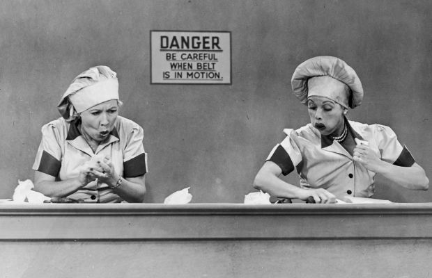 Ethel (Vivian Vance) and Lucy (Lucille Ball) binge for laughs in the famous chocolate factory scene in 'I Love Lucy.' (Photo: Getty Images)