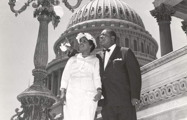 Louis Armstrong: Louis Armstrong stands on Capitol Hill with his wife Lucille. (Getty Images)