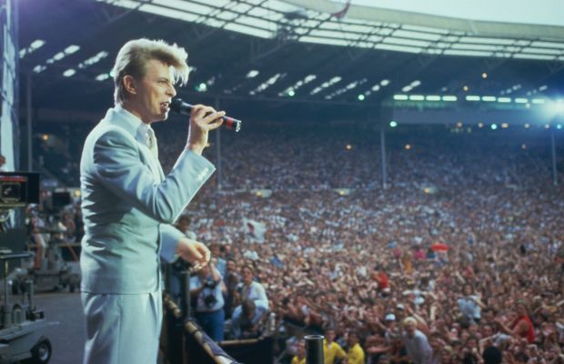 David Bowie: Bowieonstageat Bob Geldorf's Live Aid concert,which raisedfunds for Ethiopian famine relief,at Wembley Stadium in London, 1985. (Photo by Georges De Keerle/Getty Images)