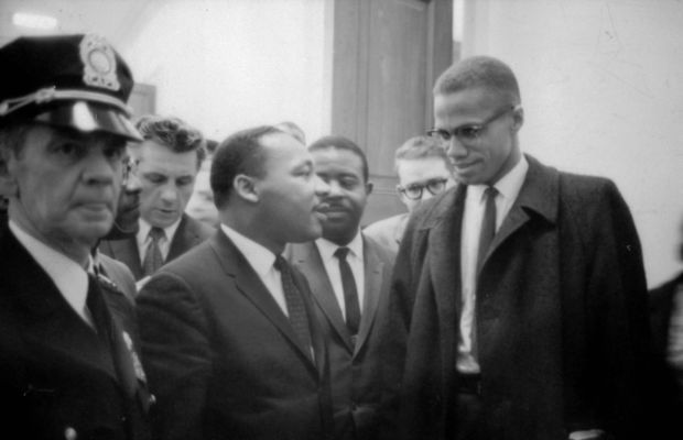 Malcolm X: Civil rights activists Martin Luther King, Jr. and Malcolm X have a meeting of the minds as they wait for a press conference on March 26, 1964. (Photo by Universal History Archive/Getty Images)