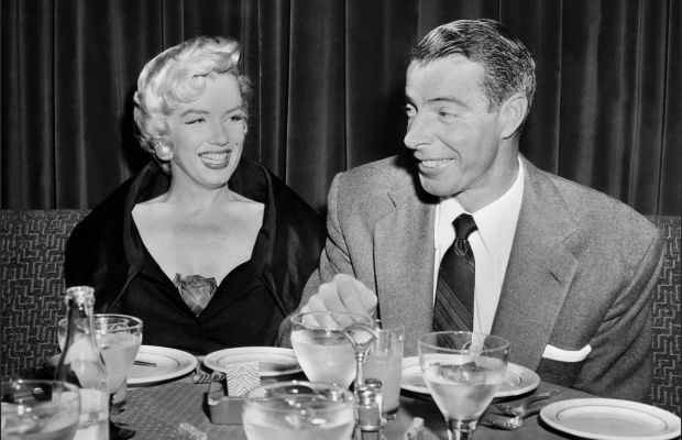 Marilyn Monroe Photo Gallery: In 1951 Joe DiMaggio saw a picture of Monroe with two Chicago White Sox players, but did not ask the man who arranged the stunt to set up a date until 1952.