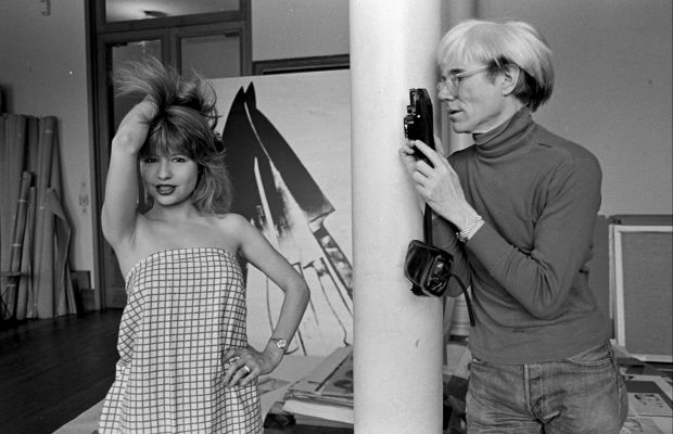Andy Warhol: Though the people around him changed, Warhol was always on the lookout for the next new superstar. Here he is photographing Pia Zadora in 1983.