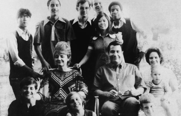 Cult Leader Jim Jones sits with his wife, children, and extended family in this portrait taken just two years before the mass suicide he orchestrated in 1978. (Getty)