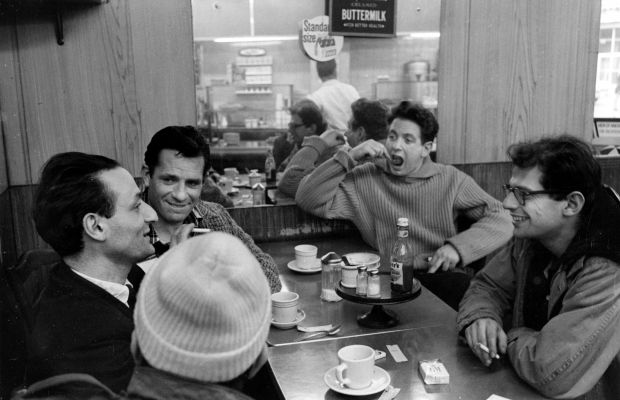 The Beatniks breaking bread. [Left to right] Painter and musician Larry Rivers, Kerouac, poet Gregory Corso {back of head), musician David Amram, and poet Allen Ginsburg in the late 1950s. (Getty)