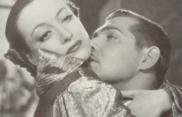 "Joan Crawford and Clark Gable in the 1934 film ""Chained."""