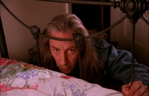 Terrifying Bob (Frank Silva) crouching by Laura's bed.