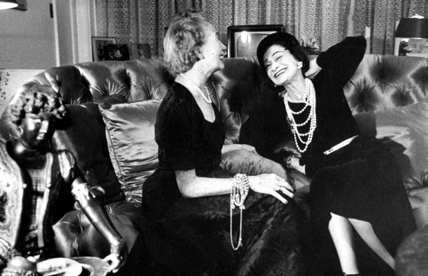 Chanel (right) with Harper's Bazaar editor Carmel Snow (left) in the 1950s. (Getty)