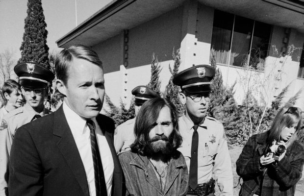 "After his arrest for the ""Tate-LaBianca murders,"" Charles Manson walks to a preliminary hearing of the case in December 1969. (Photo by Vernon Merritt III/Time Life Pictures/Getty Images)"