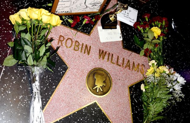 Flowers and mementos memorialize Robin Williams' star on the Hollywood Walk of Fame. (Photo by Kevin Winter/Getty Images)