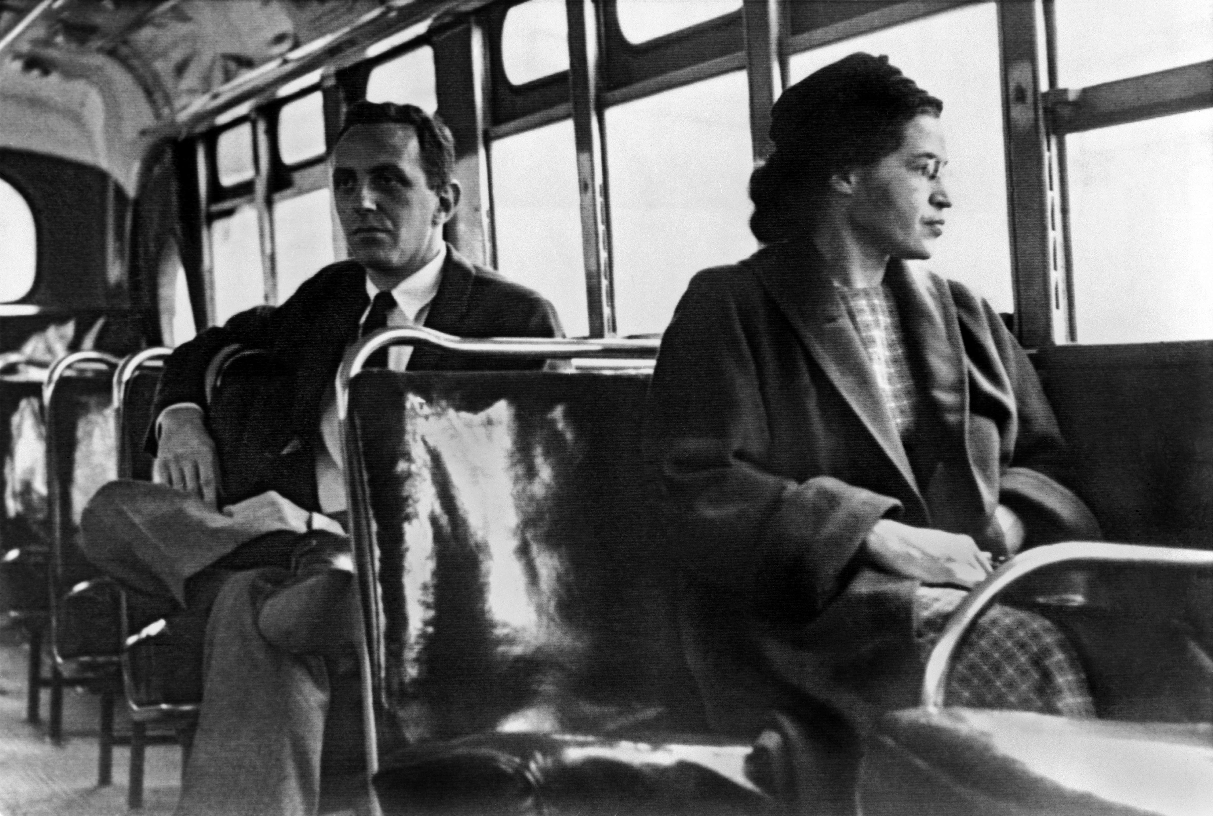 Civil Rights Activists: A key figure of the Civil Rights Movement, Rosa Parks sits near the front of a bus in Montgomery, Alabama in 1956, just one year after she was arrested for refusing to give up her seat on a bus in the city, leading to the Montgomery bus boycott. (Photo by Underwood Archives/Getty Images)
