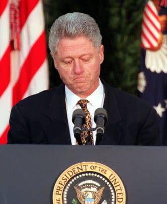US President Bill Clinton apologizes to the nation