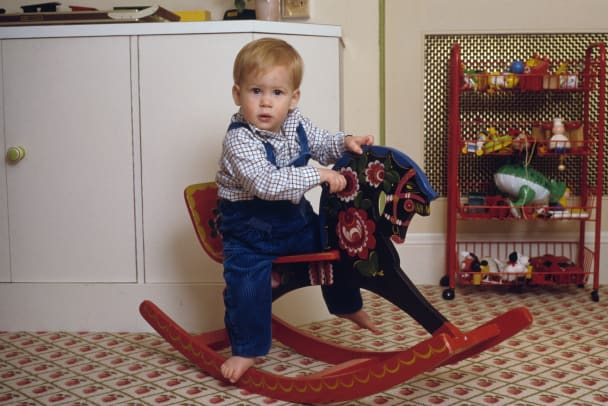 Prince Harry on a rocking horse in the playroom at Kensington Palace, London, 22nd October 1985. (Photo by Tim Graham:Getty Images)