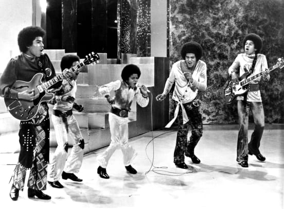 """Jackson 5"" perform on a TV show in circa 1969. (L-R) Tito Jackson, Marlon Jackson, Michael Jackson, Jackie Jackson, Jermaine Jackson. (Photo by Michael Ochs Archives:Getty Images)"
