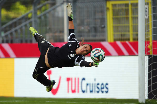 Nadine Angerer makes a save during a Germany training session at Carl-Benz-Stadion on April 9, 2014 in Mannheim, Germany. (Photo by Alex Grimm:Bongarts:Getty Images)