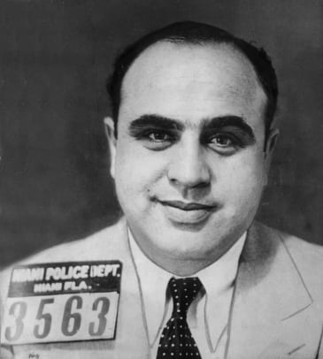 Al Capone (1899 - 1947) smiling in a jacket and tie, Miami, Florida. (Photo by Hulton Archive_Getty Images
