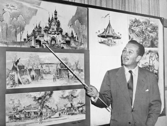 1_American producer, director, and animator Walt Disney (1901 - 1966) uses a baton to point to sketches of Disneyland, 1955. (Photo by Hulton Archive:Getty Images)