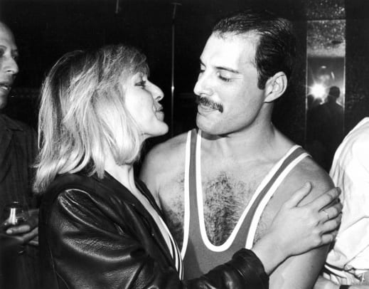 1_Freddie Mercury (1946 - 1991) of British rock band Queen with his friend Mary Austin, during Mercury's 38th birthday party at the Xenon nightclub, London, UK, September 1984. (Photo by Dave Hogan:Getty Images)